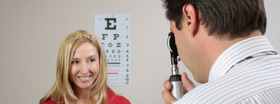 A female patient having her eyes checked by an eye doctor.